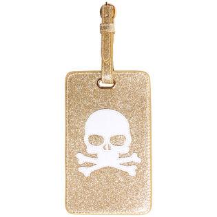 Étiquette de bagage dorée à motif de tête de mort